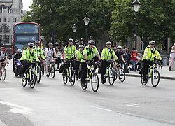 "Police officers on bikes riding past Trafalgar Square, London, as armed troops have been deployed to guard ""key locations"" under Operation Temperer, which is being enacted after security experts warned the Government that another terrorist attack could be imminent."
