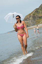 @ Licensed to London News Pictures. 14/07/2013. <br /> 27 year old BIANCA ZIETSMAN enjoying the continuing hot sunny weather on the beach at the seaside resort of Aberystwyth on the Cardigan Bay coast, West Wales UK. Temperatures in the UK have broken 30 degrees celsius this weekend. Photo credit: Keith Morris/LNP