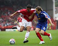 Photo: Rich Eaton.<br /> <br /> Bristol City v Crewe Alexander. Coca Cola League 1. 14/10/2006. Bristols goalscorer Scott Murray left takes on David Murray of Crewe