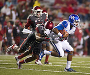 Arkansas Razorbacks tailback Jonathan George (25) brings down Kentucky Wildcats quarterback Jalen Whitlow (13) during the first half of a game at Donald W. Reynolds Razorback Stadium in Fayetteville, Ark., on Oct.. 13, 2012. Photo by Beth Hall