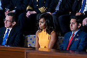 First Lady Michelle Obama looks on as U.S. President Barack Obama delivers the State of the Union address to a joint session of Congress at the Capitol in Washington, D.C., U.S., on Tuesday, Jan. 12, 2016. Obama said he regrets that political divisiveness in the U.S. grew during his seven years in the White House and he plans to use his final State of the Union address Tuesday night to call for the nation to unite. Photographer: Pete Marovich/Bloomberg *** Local Caption *** Barack Obama