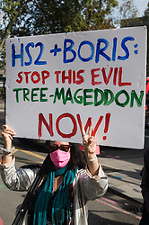 Activists from HS2 Rebellion, an umbrella campaign group comprising longstanding campaigners against the HS2 high-speed rail link as well as Extinction Rebellion activists, march to a protest rally in Parliament Square on 4 September 2020 in London, United Kingdom. The rally, and a later protest action at the Department of Transport during which activists glued themselves to the doors and pavement outside and sprayed fake blood around the entrance, coincided with an announcement by HS2 Ltd that construction of the controversial £106bn high-speed rail link will now commence.