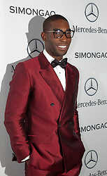 © Licensed to London News Pictures. 18 February 2014, London, England, UK. Pictured: Tinie Tempah. Celebrities attend the Mercedes-Benz sponsored SIMONGAO show during London Fashion Week AW14 at the BFC Courtyard Show Space/Somerset House. Photo credit: Bettina Strenske/LNP