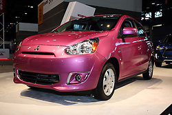 12 February 2015:   2015 MITSUBISHI MIRAGE: On display at the 2015 Chicago Auto Show is the most fuel efficient non-hybrid gasoline vehicle available in America today. We're talking a combined fuel economy of 40-mpg. Every '15 Mirage DE and Mirage ES is front-wheel drive and fitted with a fuel-sipping 1.2-liter three-cylinder DOHC engine that produces 74-horsepower. Buyers have a choice of precise shifting five-speed manual or a high-tech continuously-variable transmission (CVT).  The five-door subcompact's curb weight of just less than one ton, gives the 2015 Mirage a better power-to-weight ratio than its competitors. The Mirage offers plenty of standard equipment, along with new upscale features, and very affordable pricing. It's a great new vehicle for first-time drivers, retirees, short-hop urban dwellers or those with marathon commutes. New starting this year are side view mirrors with turn indicators, new chrome interior trim accents and new interior seat fabric. There are amenity and accessory packages available including push-button start, Bluetooth, LED Illumination, front and rear park assist sensors, exterior and chrome packages, as well as a navigation package that includes a SD Card-based navigation system with rearview camera. Other thoughtful interior design touches include several handy storage compartments/trays and large cup holders, split-fold rear seats, a generous 17.2 cubic feet of rear cargo volume and an included cover for the rear cargo area. Available fun exterior paint colors include Sapphire Blue, Kiwi Green, Infra Red, Plasma Purple, Cloud White, Mystic Black, Starlight Silver and Thunder Gray.<br /> <br /> First staged in 1901, the Chicago Auto Show is the largest auto show in North America and has been held more times than any other auto exposition on the continent. The 2015 show marks the 107th edition of the Chicago Auto Show. It has been  presented by the Chicago Automobile Trade Association (CATA) since 1935.  It is held at McCormi