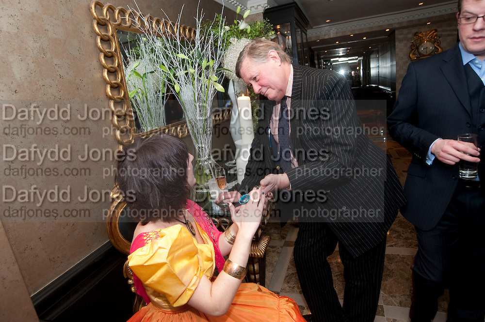 MICHAEL WHITELOCK HAVING HIS PALM READ, Liz Brewer GIVES A PARTY TO WELCOME 2010, Champagne <br /> Flemings Mayfair, 13 Half Moon Street, London. 5 January 2010