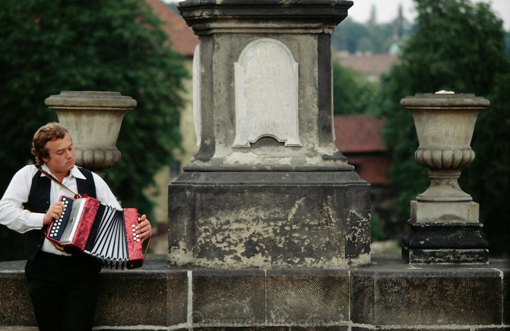 Prague, Czech Republic. Charles Bridge accordionist plays for pedestrians.