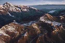 THEMENBILD - Blick auf die Strasse mit den Schnee bedeckten Bergen in der Morgensonne. Fuschertörl, Edelweissspitze. Die Grossglockner Hochalpenstrasse verbindet die beiden Bundeslaender Salzburg und Kaernten und ist als Erlebnisstrasse vorrangig von touristischer Bedeutung, aufgenommen am 11. September 2019 in Fusch a. d. Grossglocknerstrasse, Österreich // View on the road with the snow covered mountains in the morning sun, Fuschertoerl, Edelweissspitze. The Grossglockner High Alpine Road connects the two provinces of Salzburg and Carinthia and is as an adventure road priority of tourist interest, Fusch a. d. Grossglocknerstrasse, Austria on 2019/09/11. EXPA Pictures © 2019, PhotoCredit: EXPA/ JFK