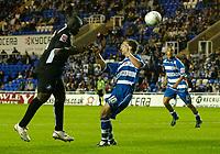 Photo: Daniel Hambury.<br /> Reading v Swansea. Carling Cup.<br /> 23/08/2005.<br /> Swansea's Adebayo Akinfenwa scores the equaliser.