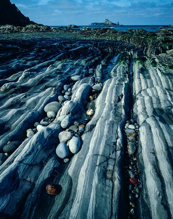 Striated rock design, north of Rialto Beach, Olympic National Park, Washington, USA