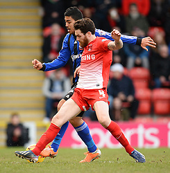 Orient's Romain Vincelot and Swindon's Massimo Luongo  compete for the ball - Photo mandatory by-line: Mitchell Gunn/JMP - Tel: Mobile: 07966 386802 22/02/2014 - SPORT - FOOTBALL - Brisbane Road - Leyton - Leyton Orient V Swindon Town - League One