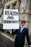 In a march organised by the Peoples Assembly, demonstrators protest  against austerity measures affecting health, education and employment, brought in by the Tory Government headed by Prime Minister David Cameron on April 16th 2016 in London, United Kingdom. Calls for Cameron's resignation followed revelations in the 'Panama Papers'. A fake David Cameron holds a placard saying Realism and responsibility.