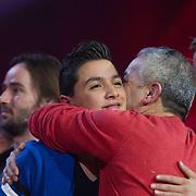 NLD/Hilversum/20140221 - Finale The Voice Kids 2014, Winnaar Ayoub Haach word omhelst door zijn vader