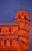 The leaning Pisa Tower at sunset.