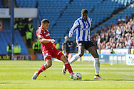 Cardiff City defender, Lee Peltier (2) battles with Sheffield Wednesday striker Lucas Joao (18) during the Sky Bet Championship match between Sheffield Wednesday and Cardiff City at Hillsborough, Sheffield, England on 30 April 2016. Photo by Phil Duncan.