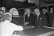 17/04/1963<br /> 04/17/1963<br /> 17 April 1963<br /> Lord Mayor of Birmingham visits Fry-Cadbury factory, Colock, Malahide Road, Dublin. Image shows:(l-r) Arthur Lyle, Joint Managing Director, Fy-Cadbury; Lord Mayor of Dublin, J.J. O'Keeffe and Lord Mayor of Birmingham, Ernest Horton examine the manufacturing process during their tour of the factory.