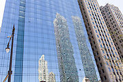 Skyscrapers reflected on the windows of a building along Wacker Drive in Chicago, Illinois, USA