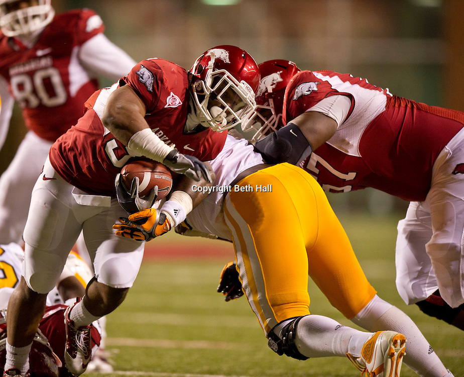 Nov 12, 2011; Fayetteville, AR, USA; Arkansas Razorback running back Dennis Johnson (33) carries the ball during the second half of a game against the Tennessee Volunteers at Donald W. Reynolds Razorback Stadium. Arkansas defeated Tennessee 49-7. Arkansas defeated Tennessee 49-7. Mandatory Credit: Beth Hall-US PRESSWIRE