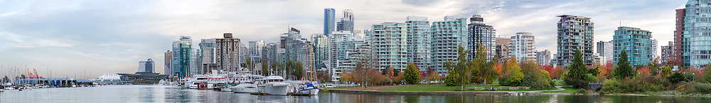 Panorama of Coal Harbour from Stanley Park.  Photograph includes Canada Place, Vancouver Trade and Convention Center, the Pan Pacific Hotel, downtown Vancouver buildings and condo towers, and Devonian Harbour Park. Photographed from the Stanley Park seawall along the western end of Coal Harbour in Vancouver, British Columbia, Canada.   Full resolution file is actually 35917 x 5204 pixels.