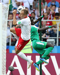 MOSCOW, June 19, 2018  Kamil Grosicki (L) of Poland competes for a header during a Group H match between Poland and Senegal at the 2018 FIFA World Cup in Moscow, Russia, June 19, 2018. (Credit Image: © Xu Zijian/Xinhua via ZUMA Wire)