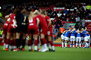 Everton Women huddle with Liverpool women huddle in the foreground during the FA Women's Super League match between Liverpool Women and Everton Women at Anfield, Liverpool, England on 17 November 2019.