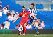 Blackburn Rovers player Craig Conway shields the ball from Brighton central midfielder Dale Stephens during the Sky Bet Championship match between Brighton and Hove Albion and Blackburn Rovers at the American Express Community Stadium, Brighton and Hove, England on 22 August 2015. Photo by Bennett Dean.