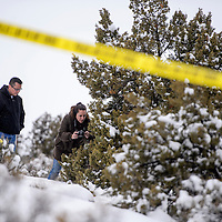 013015       Cable Hoover<br /> <br /> Gallup Police Lt Franklin Boyd and Sgt Rosanne Morrisette investigate the scene of an exposure death near N.M. highway 602 in Gallup Friday.