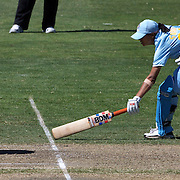 New Zealand wicket keeper Rachel Priest runs out Shravanti Naidu during the match between New Zealand and India in the Super 6 stage of the ICC Women's World Cup Cricket tournament at North Sydney  Oval, Sydney, Australia on March 17, 2009. Photo Tim Clayton