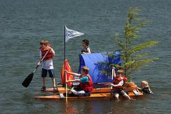"United States, Washington, Seattle, Lake Washington. ""Milk Carton Derby"", home-made boats compete."