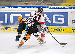 21.02.2021, Keine Sorgen Eisarena, Linz, AUT, EBEL, EHC Liwest Black Wings Linz vs iClinic Bratislava Capitals, 48. Qualifikationsrunde, im Bild v.l. Sebastien Piche (Steinbach Black Wings 1992), Maxime Fortier (iClinic Bratislava Capitals) // during the bet-at-home ICE Hockey League 48th qualifying round match between EHC Liwest Black Wings Linz and iClinic Bratislava Capitals at the Keine Sorgen Eisarena in Linz, Austria on 2021/02/21. EXPA Pictures © 2021, PhotoCredit: EXPA/ Reinhard Eisenbauer