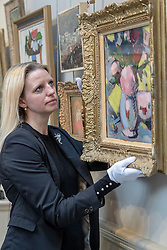The Bonham's Scottish Sale takes place at Bonham's in Edinburgh on Wednesday 25 April at 1pm. Now in its 19th year it features works by leading Scottish artists as well as a huge range of objects related to Scotland.<br /> <br /> Pictured: May Matthews, Picture Specialist with Bonhams viewing John Duncan Ferguson's Still Life valued between £70.000 and £1000,000