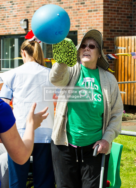 Pictured: Surrene Baker was on top form in the sun<br /> <br /> First-ever care home games tournament took place over two days at Edinburgh's Inchview Care home. More than 90 athletes from other care homes gathered to  compete in events including javelin, curling and dancing. <br /> <br /> <br /> <br /> Ger Harley | EEm 27 July 2016