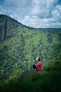 A western woman contemplates mountainous landscapes of Ella, Sri Lanka, Asia