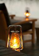 Lanterns glow at Abu Camp, a luxury safari camp in the Okavango Delta, Botswana