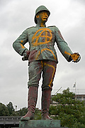 a military statue with an anarchy symbol spray painted on it Germany Hamburg