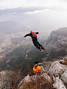 Ben Pritchard filming BASE jumping near Arco, Italy