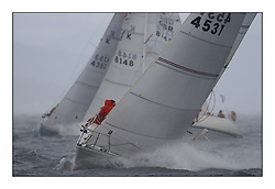 Yachting- The second start of the Bell Lawrie Scottish series 2002 at Inverkip racing to Tarbert Loch Fyne where racing continues over the weekend.<br /><br />Sigma 33 St Joan K4531 powering through a squall.<br />Class Winner<br />Pics Marc Turner / PFM