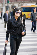 Woman walking on Nanjing Road, central Shanghai, China