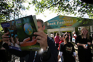 A visitor browses the official programme on the opening day of the Edinburgh International Book Festival, the world's largest literary event, with over 500 authors from across the world participating each year. Edinburgh was named the world's first UNESCO City of Literature in 2004.