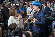 Comedian Stephen Colbert, host of Late Night jokes with House Minority Leader Nancy Pelosi and her grandchildren dressed in costume during the filming of a skit on the floor of the Democratic National Convention July 24, 2016 in Philadelphia, Pennsylvania. Colbert appeared dressed as Caesar Flickerman from the Hunger Games and continues the act from last weeks Republican Convention.