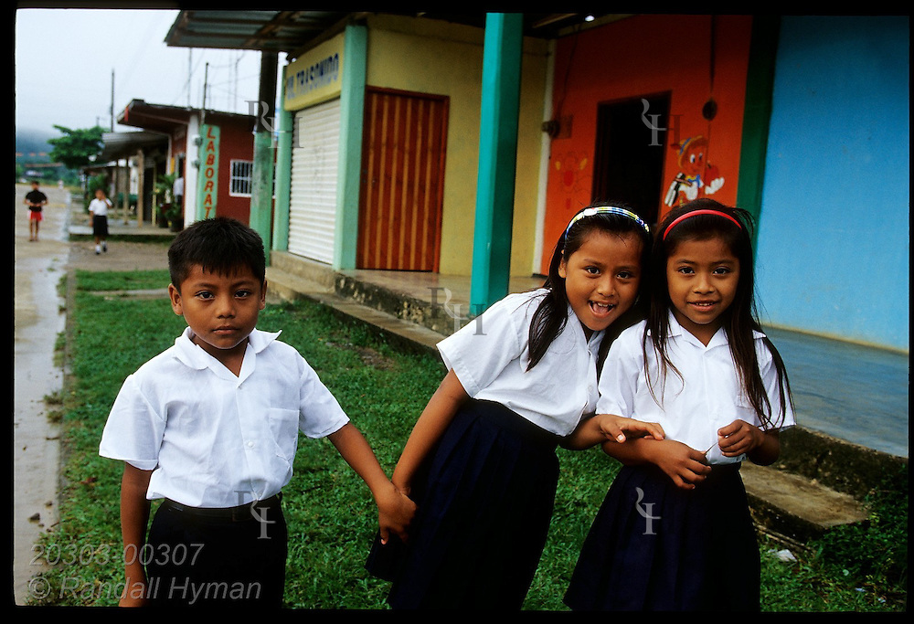 Kids in school uniforms pose outside shops on main street in town of La Chinantla in Uxpanapa Valley, southern Veracruz, Mexico.