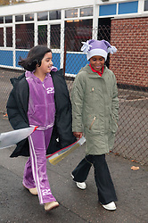 Two children walking to school,