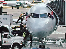 An American Airlines jet is prepared for its inaugural scheduled service from Miami to Cuba.Photo by Al Diaz/Miami Herald/TNS/ABACAPRESS.COM