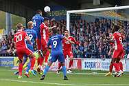 AFC Wimbledon defender Deji Oshilaja (4) winning header in the box during the EFL Sky Bet League 1 match between AFC Wimbledon and Scunthorpe United at the Cherry Red Records Stadium, Kingston, England on 15 September 2018.