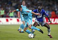 Fotball<br /> Frankrike 2003/04<br /> Toulouse v Olympique Marseille<br /> 15. mai 2004<br /> Foto: Digitalsport<br /> NORWAY ONLY<br /> <br /> RUDOLF SKACEL (OM) / ACHILLE EMANA (TOU)