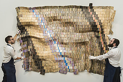March 29, 2019 - London, UK - Technicians present ''Zebra Crossing 2'', 2007, by El Anatsui (Est. GBP 550,000-750,000). Preview of Sotheby's upcoming Modern and Contemporary African Art sale.  Works from artists across the African diaspora will be offered for sale on 2 April. (Credit Image: © Stephen Chung/London News Pictures via ZUMA Wire)