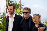 Actor Tomasz Kot, Director Pawel Pawlikowski, actress Joanna Kulig  at the Cold War film photo call at the 71st Cannes Film Festival, Friday 11th May 2018, Cannes, France. Photo credit: Doreen Kennedy