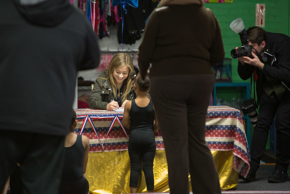 Olympic gold medalist Shawn Johnson visits young gymnasts at the Athletic Arts Academy in Orange.  2/24/16  Photo by John O'Boyle