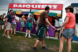28 April 2013. New Orleans, Louisiana,  USA. .Faces in the crowd. Daiquiris at the New Orleans Jazz and Heritage Festival. .Photo; Charlie Varley.