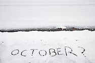 """Middletown, New York  - """"October?"""" is written on a snow-covered sidewalk during a snowstorm on Oct. 29, 2011."""