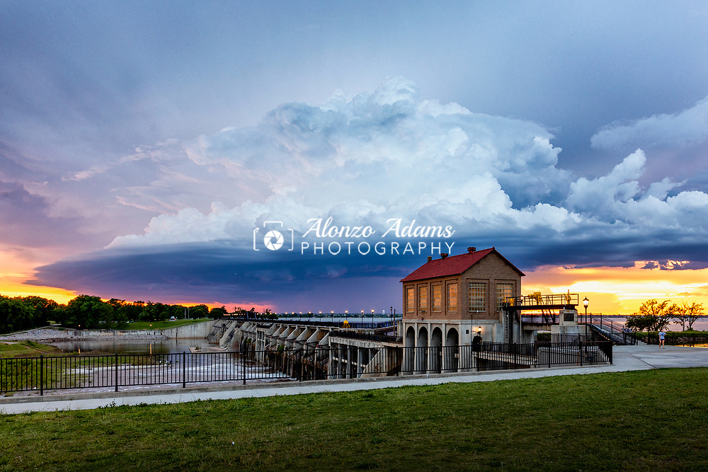 A severe thunderstorm passes near the Lake Overholser Dam at sunset in Oklahoma City on May 13, 2019. Photo copyright © 2019 Alonzo J. Adams.